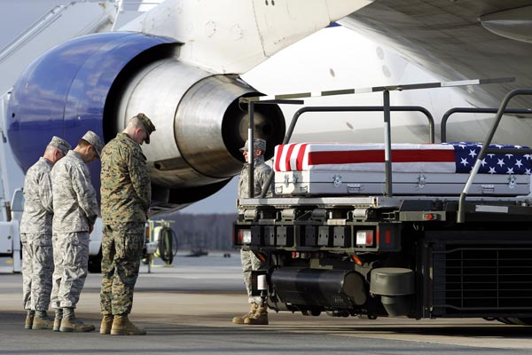 Chaplain Lt. Col. Douglas Arendsee, left, reads a prayer over the transfer case containing the remains of Marine Sgt. Matthew T. Abbate of Fresno, Calif., upon arrival at Dover Air Force Base, Del. on Saturday, Dec. 4, 2010. The Department of Defense announced the death of Marine Sgt. Matthew T. Abbate who was supporting Operation Enduring Freedom in Afghanistan. <span class=meta>(AP Photo, Marine Sgt. Matthew T. Abbate)</span>