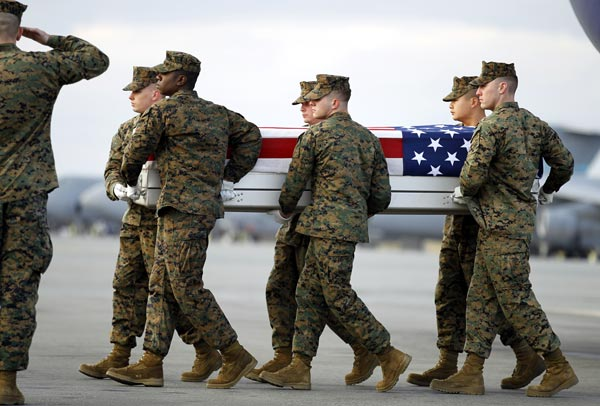 A Marine carry team carries the transfer case containing the remains of Marine Sgt. Matthew T. Abbate of Fresno, Calif., upon arrival at Dover Air Force Base, Del. on Saturday, Dec. 4, 2010. The Department of Defense announced the death of Marine Sgt. Matthew T. Abbate who was supporting Operation Enduring Freedom in Afghanistan. <span class=meta>(AP Photo&#47;Jose Luis Magana)</span>