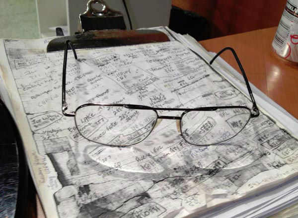 These are the clipboard and glasses of the most beloved broadcaster in Fresno&#39;s history. When Angelo walked away from the weather center today, I glanced at these and it struck me how special they are. There aren&#39;t many people that use clipboards in today&#39;s workplace. Look closely at the top page. It&#39;s a copy of a copy of a copy of a copy, you get the idea. Angelo wrote the names and phone numbers of his weather spotters and info sources on a piece of paper over the years. When it became tattered, he made a copy of the original, and new copies of the copy when necessary. Under that top sheet were the analysis and forecast charts that he used for the prior weeks. The clipboard itself is worn and somewhat rusted. I watched him use this clipboard on air at times over the years. When I took this picture, I must admit I got emotional. Angelo is leaving today. So are his glasses and this clipboard. I hope you enjoyed seeing this. We all will miss Angelo Stalis. He is honestly the sweetest person I have ever known. I can&#39;t fill his shoes! I will do my best to make him proud and follow his examples. Angelo, you are a blessing. - love you friend, Kev <span class=meta>(Kevin Musso)</span>