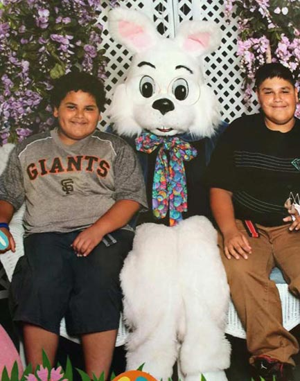 "<div class=""meta ""><span class=""caption-text "">Kids pose for a photo with the Easter bunny. (Facebook / Danny Benavides)</span></div>"