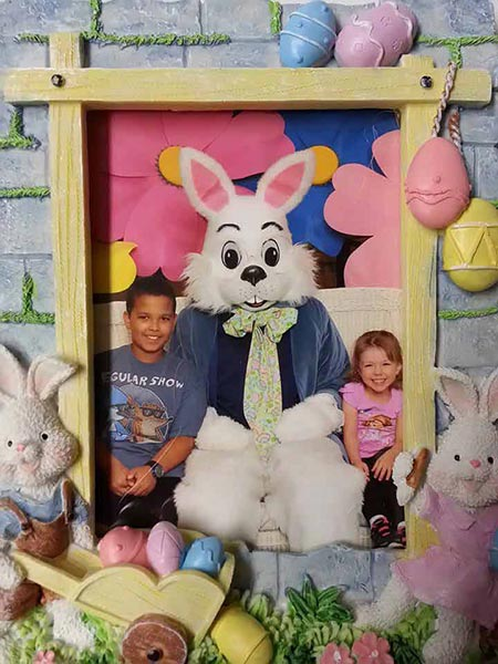 "<div class=""meta ""><span class=""caption-text "">Kids pose for a photo with the Easter bunny. (Facebook / William Beuttenmuller)</span></div>"