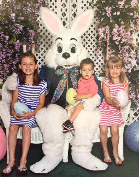 "<div class=""meta ""><span class=""caption-text "">Kids pose for a photo with the Easter bunny. (Facebook / Kristen Bishel)</span></div>"