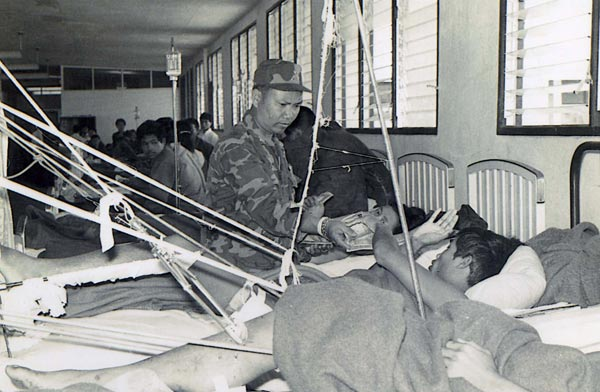 General Vang Pao visiting wounded soldiers at the medic center in Sam Thong, Laos. <span class=meta>(The General Vang Pao family)</span>