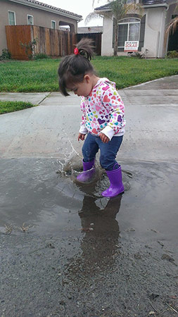 Today we learned the importance of splashing in rain puddles! What an awesome storm we had! <span class=meta>(Facebook &#47; Terasa Reyes)</span>