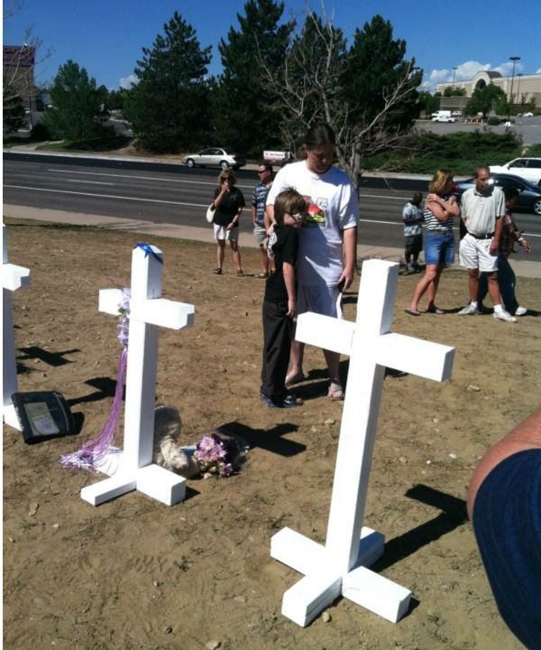 A woman and her son visit the memorial site.
