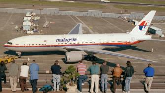 Boeing employees watched and welcomed the New 777-200IGW roll in from its round-the-world record setting flight at Boeing Field in Seattle, Wednesday, April 2, 1997.