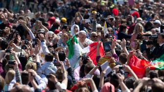 Pope Francis greets the faithful after celebrating an Easter Sunday Mass in St. Peters Square at the Vatican Sunday, April 20, 2014.