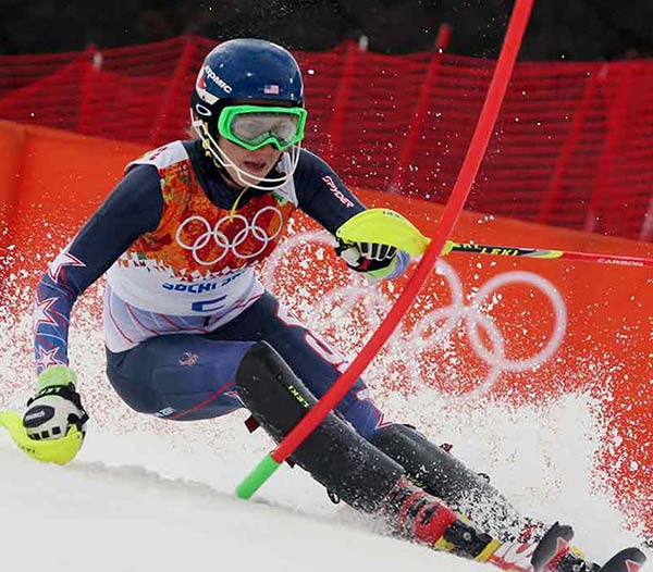 18-year-old Mikaela Shiffrin wins Olympic slalom By HOWARD FENDRICH   KRASNAYA POLYANA, Russia &#40;AP&#41; - Normally so composed, so in control, so not-very-teenlike on and off the slopes, Mikaela Shiffrin suddenly found herself in an awkward position halfway through the second leg of the Olympic slalom. 	 Guilty, perhaps, of charging too hard as she swayed this way and that around the course&#39;s gates, Shiffrin briefly lost her balance. Her left ski rose too far off the snow. Her chance at a gold medal in the event she&#39;s dominated for two years was about to slip away. 	 &#34;Yeah, that was pretty terrifying for me. There I was, I&#39;m like, &#39;Grrreat. I&#39;m just going to go win my first medal.&#39; And then, in the middle of the run, I&#39;m like, &#39;Guess not,&#39;&#34; the American said with a laugh Friday night. &#34;So like, &#39;No. Don&#39;t do that. Do not give up. You see this through.&#39; My whole goal was to just keep my skis moving.&#34; 	 Somehow, she did just that. Shiffrin stayed upright, gathered herself and, although giving away precious time there, was able to make a big lead from the first leg stand up. She won by more than a half-second to become, at 18, the youngest slalom champion in Olympic history. 	 &#34;It&#39;s going to be something that I chalk up as one of my favorite experiences for the rest of my life,&#34; Shiffrin said. &#34;But my life&#39;s not over yet.&#34; 	 No, Mikaela, it&#39;s not. It&#39;s only just beginning. Think about this for a moment: How might a typical American teenager have spent her Friday night? At the mall with friends? At a movie? At a high school dance? 	 Shiffrin spent hers outracing the best skiers in the world down a floodlit Rosa Khutor course, knocking aside gates with her neon yellow pole handles. She was fastest in the first run, then sixth-fastest in the second, for a combined time of 1 minute, 44.54 seconds. 	 A pair of Austrians won silver and bronze: Marlies Schild was 0.53 behind Shiffrin, and Kathrin Zettel was 0.81 back. At 32, Schild is the oldest Olympic slalom medalist ever - old enough to have been someone Shiffrin looked up to as, well, even more of a kid than she is now. 	 &#34;I won my age class,&#34; Schild joked. 	 She holds the record with 35 career World Cup slalom wins and now owns three Olympic medals in the discipline, two silvers and a bronze. 	 &#34;You know what&#39;s surreal? That Marlies and Mikaela are on a podium together,&#34; said Shiffrin&#39;s father, Jeff. &#34;Marlies, she&#39;s battled, she&#39;s had injuries, but she&#39;s been the queen of slalom. Mikaela has said, &#39;I&#39;ve channeled Marlies.&#39;&#34; 	 Shiffrin has won nine of the last 19 World Cup or world championship slaloms; no one else has won more than two in that span. Last year, her slalom world title made her the youngest champion in any event since 1985. 	 Talk about precocious. And serious-minded, too. Since she was about 13, Shiffrin has jotted down thoughts in notebooks, about skiing, yes, but also about what sorts of questions might arise from reporters. 	 &#34;I first met her when she was 16, and I realized right away that she is one of a kind,&#34; said Roland Pfeifer, the U.S. women&#39;s technical coach. &#34;She wants to know everything about skiing. The way she trains, the volume she trains, she probably is 25 already.&#34; 	 Shiffrin got a cold while in Russia, so she spent Friday morning drinking orange juice and trying to relax. 	 After her terrific opening run, she listened to music and did word searches. 	 Like a kid killing time between classes. 	 In her Olympic debut, Tuesday&#39;s giant slalom, Shiffrin finished fifth. But the slalom is her specialty. 	 &#34;I did envision this moment so many times,&#34; said Shiffrin, who wore a stars-and-stripes &#34;USA&#34; temporary tattoo on her neck. &#34;On the chairlift ride to the start in the second run, I started crying a little bit. I started tearing up, because I was like, &#39;This actually might happen, and I don&#39;t know what to think if it does.&#39;&#34; 	 Older, more accomplished racers faltered. 	 Three-time Olympic gold medalist Maria Hoefl-Riesch of Germany was in second after the afternoon&#39;s opening run but faded to fourth in what she said would be her last Winter Games race. 	 Tina Maze of Slovenia, who won Sochi golds in the downhill and giant slalom, went from third in the opening leg to eighth. 	 &#34;She&#39;s young. She&#39;s free. She doesn&#39;t think too much,&#34; Maze said about Shiffrin. &#34;She&#39;s just doing it easy. For that age, I&#39;m really impressed.&#34; 	 Shiffrin&#39;s gold gave the United States five Alpine medals, second to Austria&#39;s seven. With one event remaining, the men&#39;s slalom Saturday, it&#39;s the second-highest total for the U.S., after eight in 2010. That American team, though, had Lindsey Vonn, now sidelined by knee surgery. 	 For quite some time, Shiffrin has been likened to Vonn, the four-time World Cup champion and two-time Olympic medalist. 	 Both are based in Colorado. Both are charismatic. Both were successful early and marked for greatness. 	 &#34;People have said that I&#39;m &#39;the next Lindsey Vonn&#39; several times, and it&#39;s the same thing with being &#39;the young Tina Maze&#39; or whoever. It&#39;s amazing to be compared to them, and I&#39;m really honored to have that comparison. But I don&#39;t want to be &#39;the young Tina Maze&#39; or &#39;the next Lindsey Vonn,&#39;&#34; she said. &#34;I want to be Mikaela Shiffrin.&#34; 	 Which is a pretty good thing to be right now. 	 ___ 	 AP Sports Writers Graham Dunbar, Andrew Dampf and Pat Graham contributed to this report. <span class=meta>(AP&#47;Alessandro Trovat)</span>