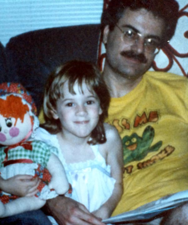 Stephanie Stone in 1985, reading to Raggedy Ann...