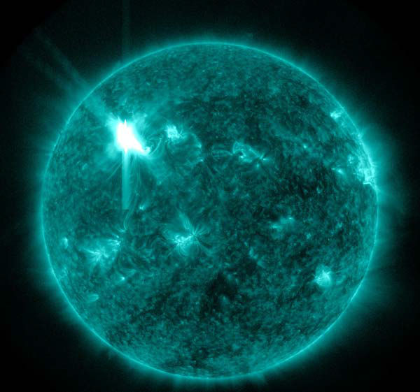 This extreme ultraviolet wavelength image provided by NASA shows a solar flare. An impressive solar flare is heading toward Earth and could disrupt power grids, GPS and airplane flights. An impressive solar flare is heading toward Earth and could disrupt power grids, GPS and airplane flights. Forecasters at the National Oceanic and Atmospheric Administration&#39;s &#40;NOAA&#41; Space Weather Prediction Center said the sun erupted Tuesday evening and the effects should start smacking Earth late Wednesday night, close to midnight EST. They say it is the biggest in five years and growing. <span class=meta>(AP Photo&#47; NASA)</span>