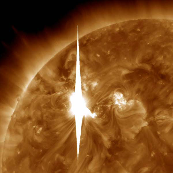 This handout image provided by NASA shows a solar flare heading toward Earth. An impressive solar flare is heading toward Earth and could disrupt power grids, GPS and airplane flights. An impressive solar flare is heading toward Earth and could disrupt power grids, GPS and airplane flights. Forecasters at the National Oceanic and Atmospheric Administration&#39;s &#40;NOAA&#41; Space Weather Prediction Center said the sun erupted Tuesday evening and the effects should start smacking Earth late Wednesday night, close to midnight EST. They say it is the biggest in five years and growing. <span class=meta>(AP Photo&#47; NASA)</span>