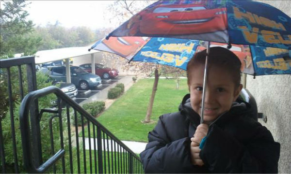 "<div class=""meta ""><span class=""caption-text "">Today my son is ready for the rain he said what a beautiful day he's on his way to school this picture was taken at our home in fresno figarden loop area at 10.50 am (KFSN Photo/ uReport)</span></div>"