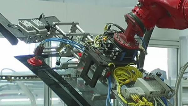 Students get tour of Tesla factory