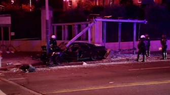 car smashed into Muni bus stop
