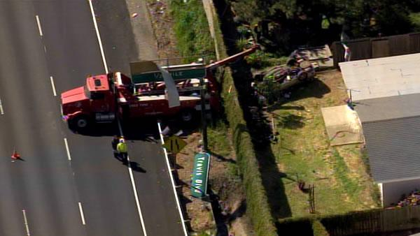 Car falls into Fairfield backyard from freeway