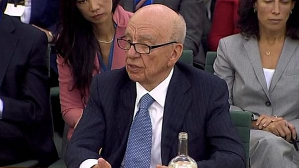 Murdoch rejects blame for hack scandal at hearing