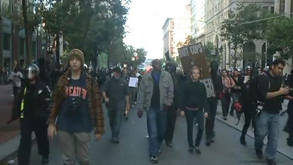 Protesters march up and down Market Street