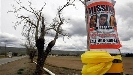 A missing person poster depicting Sierra LaMar is posted at the intersection of Dougherty and Palm Avenues Monday, March 26, 2012, in Morgan Hill, Calif. This was the intersection where LaMar missed her bus to Sobrato High School on March 16.