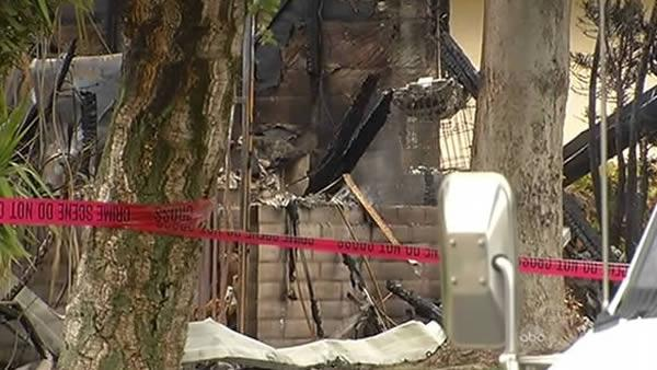 Body found in burned home after daylong standoff