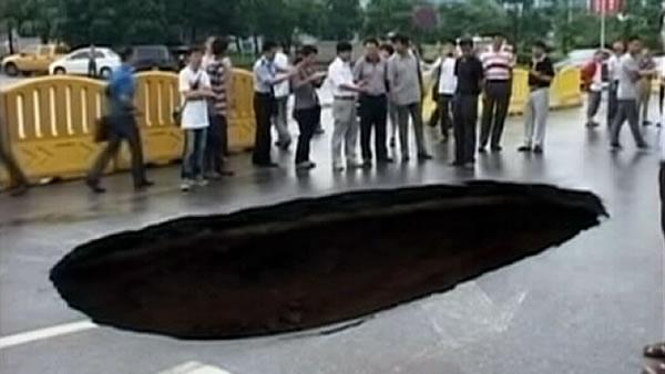 Minivan swallowed up by sinkhole in China