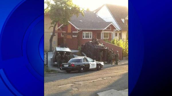SWAT team surrounds Oakland home, 2 suspects