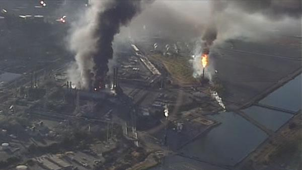 Refinery fire fully contained but continues to burn