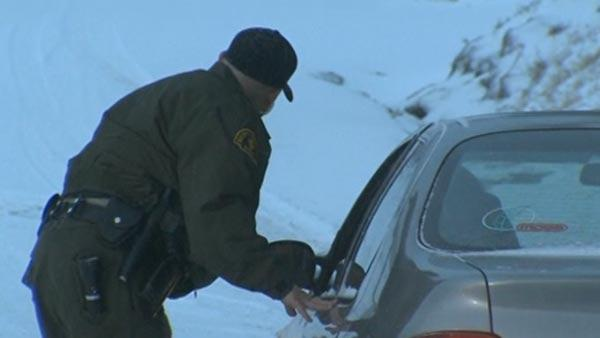 Hunt for ex-officer goes on amid snowstorm