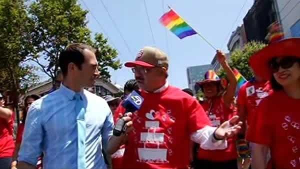 San Francisco Mayor Ed Lee talks to ABC7 News reporter Sergio Quintana about the surge in same-sex marriages, while walking down Market Street during the annual gay pride parade Sunday, June 30, 2013.