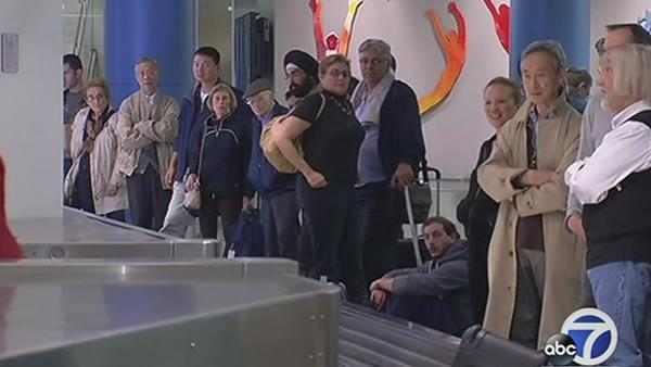 Travelers impacted by LAX shooting arrive at SFO