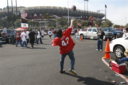 Fans toss a football around outside of Candlestick Park during the Oakland Raiders vs&#39; San Francisco 49ers NFL preseason football game in San Francisco, Calif., Saturday, Aug. 22, 2009. <span class=meta>(AP Photo&#47;Marcio Sanchez)</span>