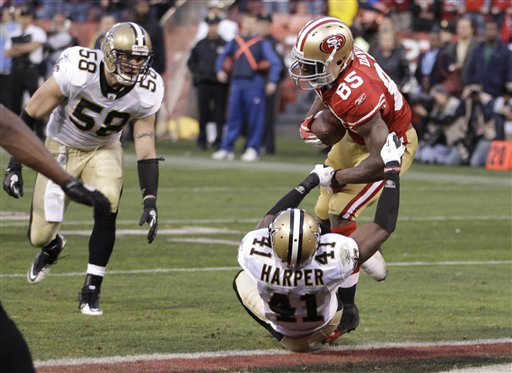San Francisco 49ers tight end Vernon Davis &#40;85&#41; scores on a 14-yard touchdown pass from quarterback Alex Smith over New Orleans Saints strong safety Roman Harper &#40;41&#41; during the fourth quarter of an NFL divisional playoff football game Saturday, Jan. 14, 2012, in San Francisco. <span class=meta>(AP Photo&#47;Paul Sakuma)</span>