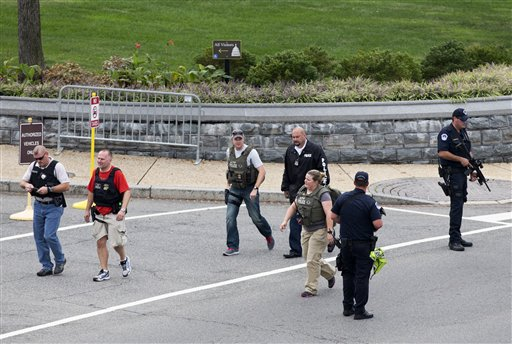 "<div class=""meta ""><span class=""caption-text "">Police and federal agents converge on the scene of a shooting on Constitution Avenue on the campus of the U.S. Capitol and near the Supreme Court, in Washington, Thursday, Oct. 3, 2013. The view is of Constitution and Delaware Ave., as seen from the Russell Senate Office Building. (AP Photo/J. Scott Applewhite)</span></div>"