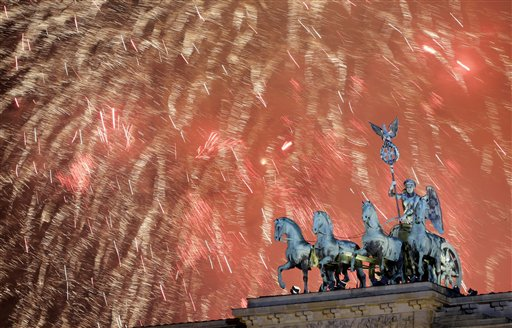 "<div class=""meta image-caption""><div class=""origin-logo origin-image ""><span></span></div><span class=""caption-text"">Germany New Year's Eve - Fireworks light the sky above the Quadriga at the Brandenburg Gate shortly after midnight in Berlin, Germany, Wednesday, Jan. 1, 2014. Hundred thousands of people celebrated New Year's Eve welcoming the new year 2014 in Germany's capital. (AP Photo/Michael Sohn)</span></div>"
