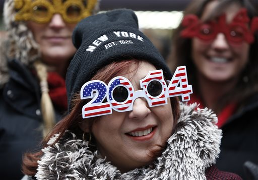 United States New Year&#39;s Eve - Carmen Glavan, of Monterrey, Mexico, wears 2014 glasses with an American theme as she and others wait in Times Square for the midnight ball drop on New Year&#39;s Eve, Tuesday, Dec. 31, 2013, in New York. The crowds will have to wait more than ten hours for the ball drop.  <span class=meta>(AP Photo&#47;Kathy Willens)</span>