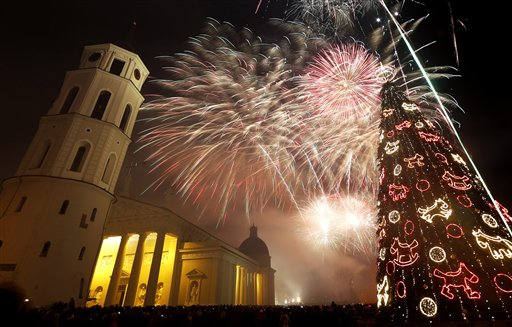 Lithuania New Year&#39;s Eve - Fireworks light the sky above the Cathedral Square in Vilnius, Lithuania shortly after midnight during the New Year&#39;s Eve celebrations, Wednesday, Jan. 1, 2014. Thousands of people celebrated the beginning of the New Year 2014 in the Lithuanian capital.  <span class=meta>(AP Photo&#47;Mindaugas Kulbis)</span>