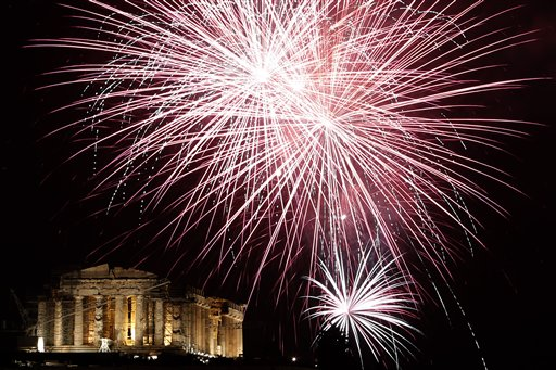 Greece New Year&#39;s Eve - Fireworks explode over the ancient Parthenon temple at the Acropolis Hill during the New Year&#39;s Eve celebrations in Athens, on Wednesday, Jan. 1, 2014. <span class=meta>(AP Photo&#47;Petros Giannakouris)</span>