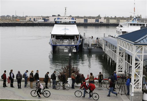 With the BART transit system on strike, people wait in line to catch a ferry to San Francisco Monday, Oct. 21, 2013, from Jack London Square in Oakland, Calif. San Francisco Bay Area commuters started the new work week on Monday with gridlocked roadways and long lines for buses and ferries as a major transit strike entered its fourth day. At the same time, federal investigators were searching for clues to a weekend train crash that killed two workers. <span class=meta>(AP Photo&#47;Eric Risberg)</span>