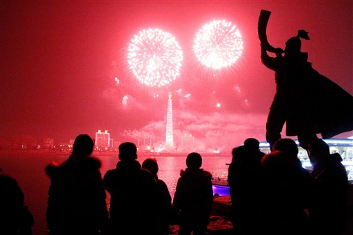 North Korea New Year&#39;s Eve - Fireworks explode over Juche Tower and the Taedong River in Pyongyang, North Korea to celebrate the New Year on Wednesday, Jan 1, 2014.  <span class=meta>(AP Photo&#47;Kim Kwang Hyon)</span>