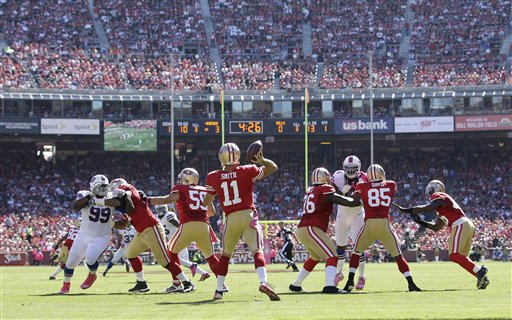 "<div class=""meta ""><span class=""caption-text "">San Francisco 49ers quarterback Alex Smith (11) against the Buffalo Bills during the first half of an NFL football game in San Francisco, Sunday, Oct. 7, 2012.  (AP Photo)</span></div>"