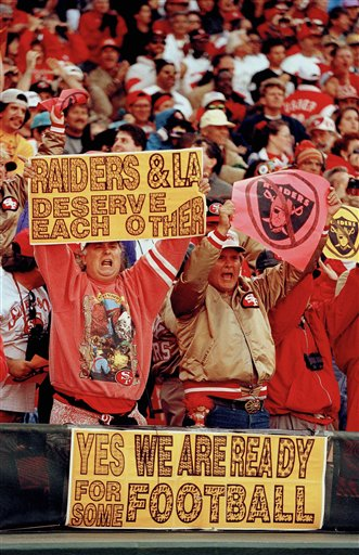 Fans at Candlestick Park in San Francisco cheer on the San Francisco 49ers at their season opening game against the Los Angeles Raiders, Sept. 5, 1994.  <span class=meta>(AP Photo&#47;Eric Risberg)</span>