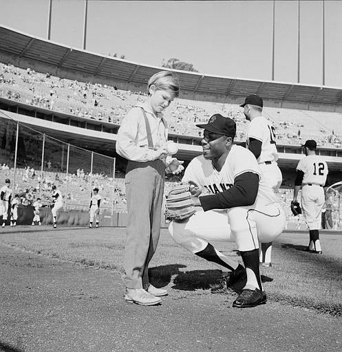 YOUNG RUSSELL MEETS HIS HERO - Kurt Russell, 12-year-old Giants fan and star of the TV series &#34;The Travels of Jamie McPheeters,&#34; receives an autographed baseball from San Francisco Giants outfielder Willie McCovey, at Candlestick Park in San Francisco, Calif., on September 3, 1963. <span class=meta>(AP Photo)</span>