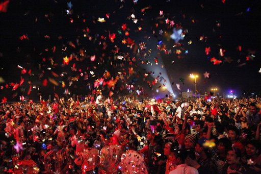 "<div class=""meta ""><span class=""caption-text "">Myanmar New Year's Eve - Revelers cheer as they enjoy performances during the New Year's Eve celebration in Yangon, Myanmar, Wednesday, Jan. 1, 2014.  (AP Photo/Khin Maung Win)</span></div>"
