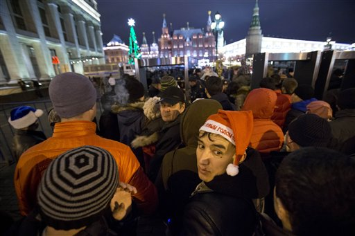 Russia New Year&#39;s Eve - People wait to be checked by police as they arriving at the Red Square ahead of the New Year&#39;s Eve festivities, in Moscow, Russia, Tuesday, Dec. 31, 2013. Russian authorities ordered police to beef up security at train stations and other facilities across the country after a suicide bomber killed 14 people on a bus Monday in the southern city of Volgograd. It was the second deadly attack in two days on the city that lies just 400 miles &#40;650 kilometers&#41; from the site of the 2014 Winter Olympics.  <span class=meta>(AP Photo&#47;Pavel Golovkin)</span>