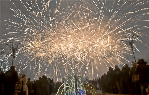 "<div class=""meta ""><span class=""caption-text "">Romania New Year's Eve - Fireworks light up the sky during New Year's celebrations in Bucharest, Romania, Wednesday, Jan. 1, 2014. Tens of thousands of Romanians took to the streets of the Romanian capital to join parties and watch fireworks. (AP Photo/Vadim Ghirda)</span></div>"