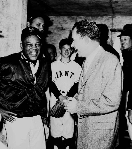 San Francisco Giants outfielder Willie Mays, left, and Vice President Richard Nixon laugh in the Giants&#39; dugout in San Francisco on April 12, 1960, prior to start of the San Francisco Giants&#39; first regular-season game at Candlestick Park. Nixon threw out the ceremonial first pitch. <span class=meta>(AP Photo)</span>