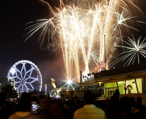 "<div class=""meta image-caption""><div class=""origin-logo origin-image ""><span></span></div><span class=""caption-text"">Philippines New Year's Eve - Fireworks light up the sky as Filipinos welcome the New Year Wednesday Jan. 1, 2014, in Manila, Philippines. Traditionally, Filipinos welcome the New Year with fireworks and firecrackers and making the loudest noise possible, including indiscriminate firing of their guns which sometimes result in injuries and deaths. (AP Photo/Bullit Marquez)</span></div>"