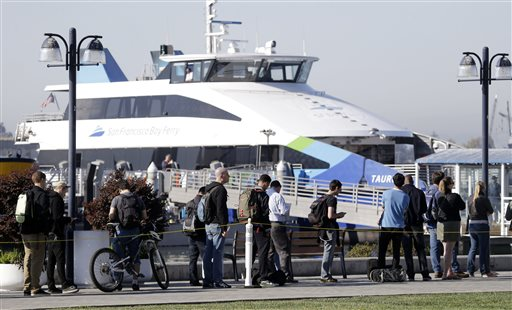 Commuters wait to board a ferry bound for San Francisco on Friday, Oct. 18, 2013, in Oakland, Calif. Commuters in the San Francisco Bay Area got up before dawn on Friday and endured heavy traffic on roadways, as workers for the region&#39;s largest transit system walked off the job for the second time in four months. <span class=meta>(&#40;AP Photo&#47;Marcio Jose Sanchez&#41;)</span>