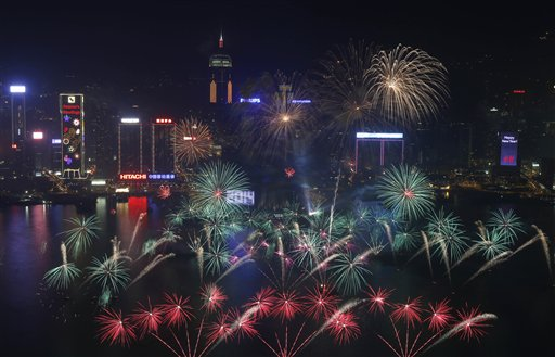 Hong Kong New Year&#39;s Eve - Fireworks explode at the Hong Kong Convention and Exhibition Centre over the Victoria Harbor during New Year&#39;s celebrations in Hong Kong, Wednesday, Jan. 1, 2014. <span class=meta>(AP Photo&#47;Kin Cheung)</span>