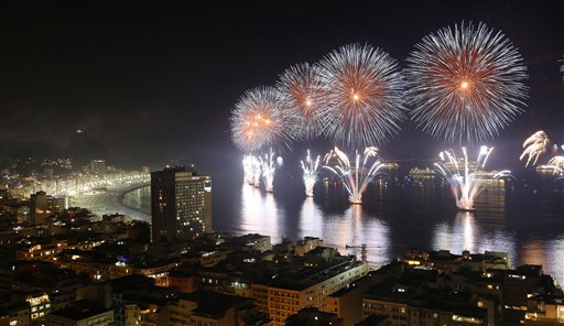 "<div class=""meta ""><span class=""caption-text "">Brazil New Year's Eve - Fireworks light the sky over Copacabana beach during New Year's Eve celebrations in Rio de Janeiro, Brazil, Wednesday, Jan. 1, 2014. (AP Photo/Leo Correa)</span></div>"