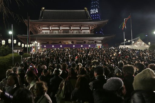 Japan New Year&#39;s Eve - People gather at the Zojoji Buddhist temple in Tokyo to celebrate the New Year, early Wednesday, Jan. 1, 2014. <span class=meta>(AP Photo&#47;Shizuo Kambayashi)</span>